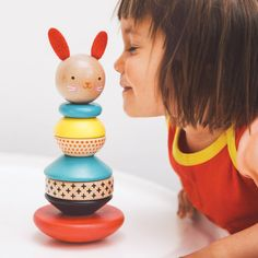 From nursery shelf to the playroom floor, our modern bunny stacking toy delivers design and delight. Toddlers love to build the bunny by stacking the polished wooden rings onto the post in any order.
