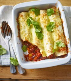 Quick beany enchiladas with loads of beans and cheese make a great vegetarian dinner for two.