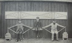 A demonstration of the mathematical principles of the original Forth Bridge in Scotland performed at Imperial College in 1887. The central 'weight' is Kaichi Watanabe, one of the first Japanese engineers to study in the UK, while Sir John Fowler and Benjamin Baker provide the supports. Photograph: Imperial College