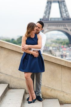 """""""Immature love says: 'I love you because I need you.' Mature love says 'I need you because I love you."""" - Erich Fromm  Engagement picture of a couple hugging in front of the Eiffel Tower, captured by Paris engagement photographer Fran Boloni"""
