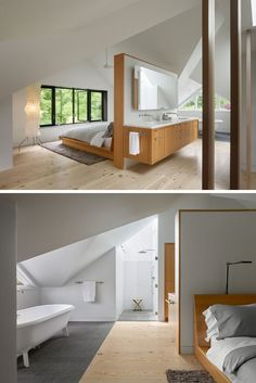 This modern master bedroom and bathroom suite look out to the treetops, while a tall white and wood headboard sits behind the bed and doubles as a wood vanity for the bathroom. Off to the side is a standalone bathtub and walk-in shower with white tiles and a glass shower door.