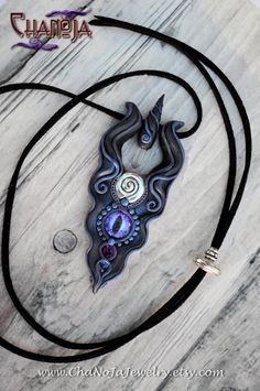 Sacred Spiral Of Life 3-Unique Mens Pendant by ChaNoJaJewelry on etsy. Sacred Spiral Of Life Purple Dragon Eye Crystal Fantasy Jewelry.  This unique dark version of the pendant comes in purple and blue shades. An outstanding piece of jewelry, very detailed sculpting work. I love its unique form and the intricate details. A true eye-catcher! :)