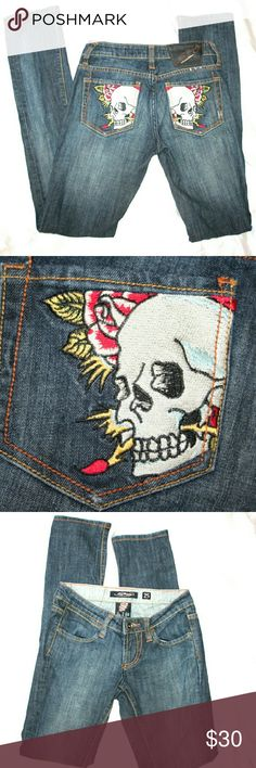 """Ed Hardy Skull and Rose Embroidered Jeans Ed Hardy By Christian Audigier jeans. Tattoo style embroidered skull and rose on back pockets. Contrast stitching. Extra low rise straight leg. Light distressing. Medium wash.  Waist 29"""". Hips 35"""" Length 42"""" Leg opening 13"""" Inseam 34"""" Rise 6 3/4"""" Back rise 13"""" Ed Hardy Jeans Skinny"""