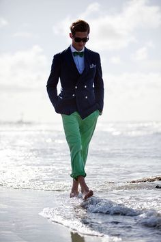 Shop this look for $128:  http://lookastic.com/men/looks/chinos-and-double-breasted-blazer-and-pocket-square-and-bow-tie-and-dress-shirt/687  — Green Chinos  — Navy Double Breasted Blazer  — White and Blue Pocket Square  — Green Vertical Striped Bow-tie  — Blue Dress Shirt