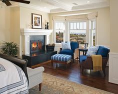 Seating area, fireplace and bay windows in master bedroom - yes please.