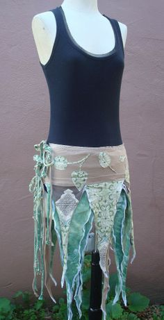 make fabric scrap, wrap skirts to wear over a leotard (all greens and woodland browns); attach a few trailing vines and/or flowers; green tights and brown slippers or calf boots (can make out of felt); point ears; wavy hair; sparkly eye make-up -- voila!  Elven costumes for A