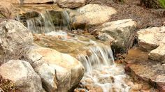 Image from http://ak0.picdn.net/shutterstock/videos/797566/preview/stock-footage-lock-down-medium-shot-of-running-water-over-rocks-in-water-garden-or-creek-could-easily-be-made.jpg.