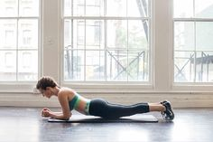 Start in a forearm plank with your hands clasped. Use your abs to lift your hips into a pike, so that your butt is high in the air. Keeping your abs tight, lower your body slowly until your thighs tap the ground, then push right back up into a pike. Do 25 reps.