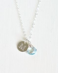 This personalized necklace features a sky blue topaz briolette and handstamped initial charm. They are suspended from a delicate chain and you can choose your chain length.  Blue topaz is a birthstone for December and this makes a great birthday gift or push present for someone born in that month!  Personalized birthstone jewelry by Blue Room Gems.
