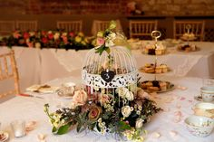 Birdcage with flowers centre piece, afternoon tea, cake stand