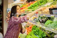 Cute brunette buying some groceries royalty-free stock photo