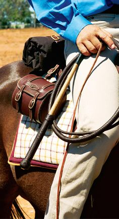 RM Williams stock whip and rider on horse • Adelaide's icons