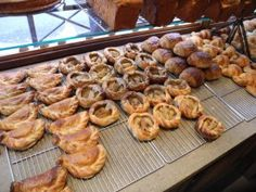 At last, after the nods to a few patisseries and the elite shops above, we hit a bread head's dream stop, the Poilâne bakery. Much smaller than I expected, the little store front was packed full of wonderful breads and viennoiserie (that's your croissants, chaussons aux pomme – apple turnovers – and the like). We nabbed ourselves a half miche
