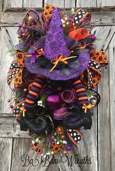 Halloween Swag, Halloween Wreath, Halloween Decor, Halloween Mesh Wreath, Fall Wreath, Fall Decor, Halloween Door Hanging, Halloween Door A Whimsical Halloween Delight! Welcome your Trick or Treaters in grand style! Such a FUN wreath this is with tons of details: orange/purple/black stripped mesh, purple, green, orange, burlap & black mesh curls, sprays of sparkling swirls, designer ribbons, spooktacular ornaments, and stunning witches hat & legs! Makes a WOW statement for ...