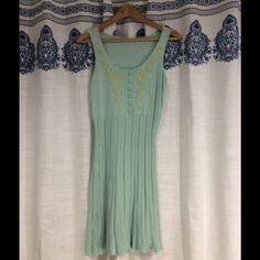 Knit dress Robins Egg Blue with light yellow stitching in front. Soft and super comfy knit dress. Very cute stitching on the front. Great shape and flows really pretty! Worn once, no signs of wear. Dresses Midi