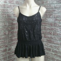 Black lace sequin peplum shirt Adjustable straps. Lace upper with sequins and full lining. Elastic stretch smocked waist ends with a ruffle peplum hem. Excellent per loved condition. Express Tops Blouses