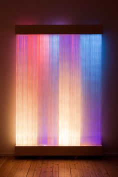 'Ikat II', a light tapestry of  paper yarn with organic patterns   created in optical fibres by Astrid Krogh.