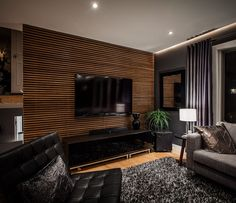 Decoration Ideas, : Attractive Home Interior And Living Room Decoration With Light Walnut Wood Slatted Wall Including Folding Tufted Black Leather Sofa And Grey Furry Area Rug