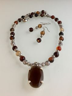 Jasper stones, glass faceted pendant, pewter with SS overlay beads, magnetic clasp.  Earrings, Jasper stone.