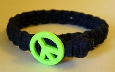 Black Jersey Bracelet with Lime Green Peace Sign Closure