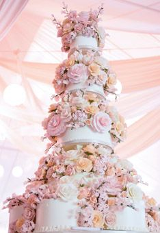 Sylvia Weinstock Wedding Cake:   chocolate and vanilla confection with fruit filling, by NYC-based cake baker Sylvia Weinstock, is covered with sugar flowers. Perfection!