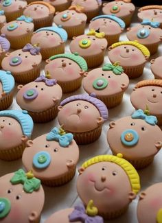 'Baby' vanilla cupcakes decorated with fondant.