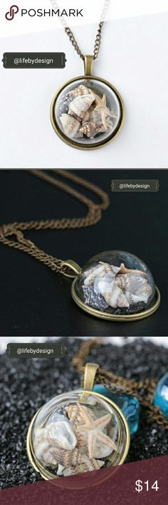 Marine Elements Glass Pendant Necklace. Material:Glass + alloys  Color: Antique Gold Color, Tans, Creams Pendant size: 33*42cm Chain length: 80cm   Very cute! Beach in a bubble to wear around your neck to remind you of the water. Life by Design  Jewelry Necklaces