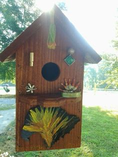 Another duded up birdhouse...broken jewelry and acrylic paint