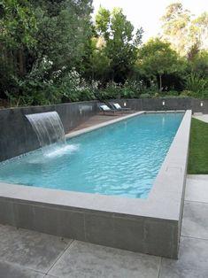 piscine béton rectangulaire avec revêtement carrelage réalisée par, Hause und garten