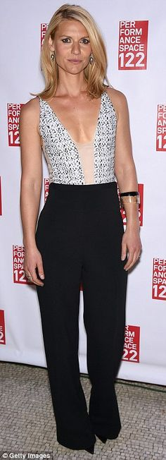 Fashion forward: The 35-year-old paired the sleeveless top with trendy wide-legged trouser...