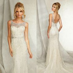 Angelina Faccenda Bridal by Mori Lee bridal gown. Open back and form fitted wedding dress. Beaded bodice and illusion neckline.