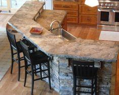 Love the concrete counter tops vs granite tops