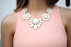 Try going for a statement necklace instead of a crazy print or a multitude of banal accessories. White Statement Necklaces, White Necklace, Statement Jewelry, Pearl Necklace, Big Necklaces, Floral Necklace, Necklace For Neckline, Jewelry Accessories, Fashion Accessories