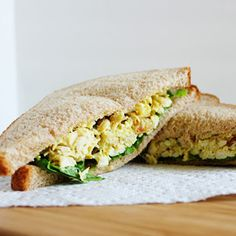 This curried chicken salad is made lighter with Greek yogurt and filled with delicious golden raisins, pecans and chopped egg.