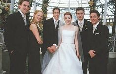 (L to R) The bridal party: SEANN WILLIAM SCOTT as Steve Stifler, JANUARY JONES as Cadence, JASON BIGGS as Jim (the groom), ALYSON HANNIGAN as Michelle (the bride), EDDIE KAYE THOMAS as Finch and THOMAS IAN NICHOLAS as Kevin in American Wedding.