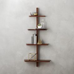 A tree-like wall shelf that really tests your reaching abilities. | 33 Products That Will Turn Your House Into A Minimalist Dream