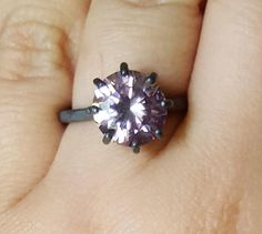 This is an insane 10.10mm VS1 pink moissanite in a sterling silver ring. You can choose below if ou want your ring oxidized (black) ou not (silver). The ring size is 7.5 and it can be change (just ask me first). The shipping is free