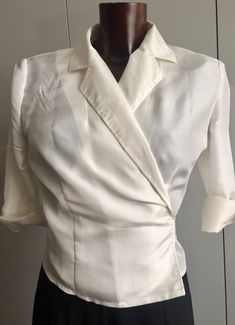 his beautiful white wrap blouse is made of pure solid silk. You can also wear it as a jacket, with a top underneath. The belt is long enough and can be tied either at the back or the front. Sleeves with 2 small buttons covered in silk each. Size from 34 to 38. He's Beautiful, Wrap Blouse, Covered Buttons, Nice Dresses, Dressing, Homemade, Belt, Pure Products, Jacket
