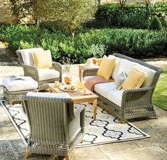 Create an intimate outdoor space with pieces from our Laurel Collection and anchor it all with a patterned outdoor rug.