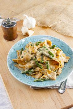 Creamy vegan cauliflower sauce with asparagus and sweet potato pasta