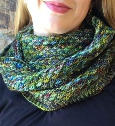 Free Knitting Pattern for Denver Cowl - The daisy stitch of this infinity scarf pattern is perfect for showcasing variegated yarn. Worsted weight yarn. Designed by Veronica Parsons. Pictured projectby Katinka