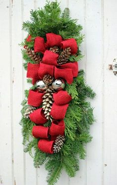 Burlap and Pine Cone Christmas Swag: Add it to your front door, fireplace, and more! This handmade Christmas decoration come with a simple tutorial!