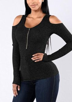 Show off some sexy shoulder skin with this black cold shoulder zip-front top.