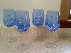 Beautiful blue wine glass hand painted with floral/swirl design. Contact me about quantity pricing.