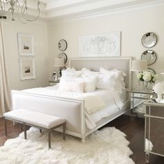 neutral easy master bedroom with restoration hardware bed, white wall, mirrored furniture, fur rug make over
