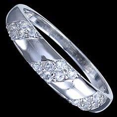 Silver ring, CZ, band Silver ring, Ag 925/1000. Rhodium finished. With stones (CZ - cubic zirconia). Elegant, wide ring ornamented by skewed band which is set by small zircons. Design width approx. 5mm.