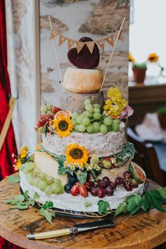 Wedding cake for the cheese lovers! Cheese Tower Stack Cake Bunting Flowers Fruit Colourful Bright S Summer Wedding Cakes, Wedding Cupcakes, Cheese Wedding Cakes, Colourful Wedding Cake, Cheese Board Wedding, Fruit Wedding, Summer Weddings, Antipasto, Cheese Tower