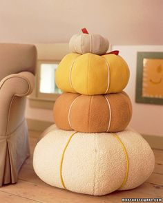 Pumpkin Pillows - These decorating ideas for a kid's room will bring his or her imagination to life. Inexpensive and inventive, these ideas allow children to be the masters of their room's fate. These portly pumpkin pillows are a delight to the eye and to little bottoms.