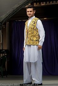 The Afghanistan traditional men clothing comes in four pieces which is the dress 'perahan', the trouser 'tunban', a golden stitch style waistcoat, a golden/silver stitch style hat and a pair of flat golden/silver stitch shoes called Paizar. The dress comes in white color with a little more embroidery on the chest and around the color and it more well and unique made.