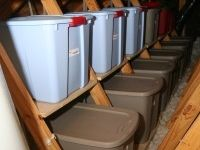 AtticMaxx shelves attach to attic trusses to eliminate stacking and unstacking of storage bins!